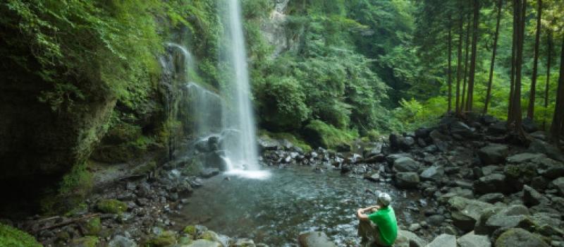 Man-watching-Waterfall